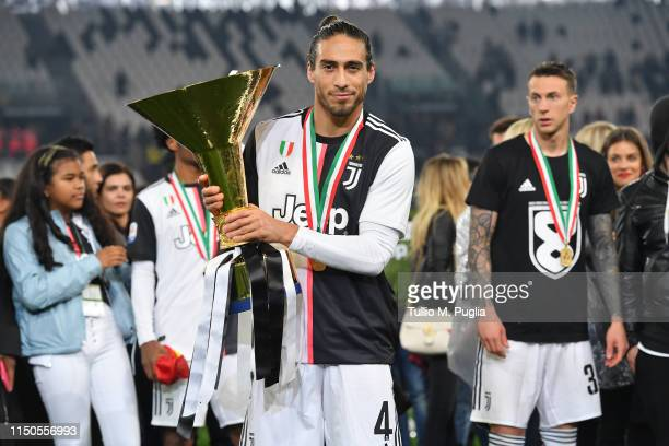 Martin Caceres of Juventus celebrates during the awards ceremony after winning the Serie A Championship during the Serie A match between Juventus and...