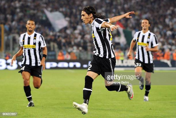 Martin Caceres of Juventus celebrates with his team mates after scoring the opeing goal during the Serie A match between Lazio and Juventus at Stadio...