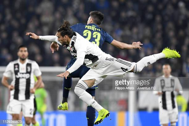 Martin Caceres of Juventus competes for the ball with Ignacio Pussetto of Udinese during the Serie A match between Juventus and Udinese at Allianz...