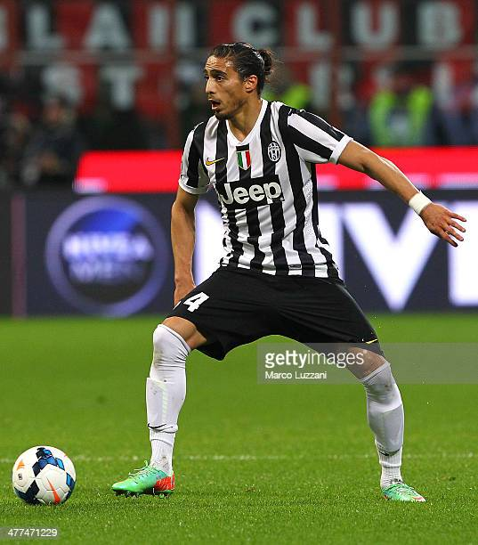 Martin Caceres of Juventus FC in action during the Serie A match between AC Milan and Juventus at San Siro Stadium on March 2 2014 in Milan Italy