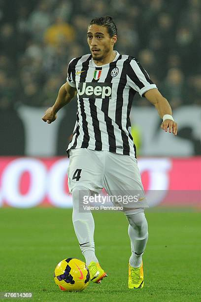 Martin Caceres of Juventus in action during the Serie A match between Juventus and Torino FC at Juventus Arena on February 23 2014 in Turin Italy