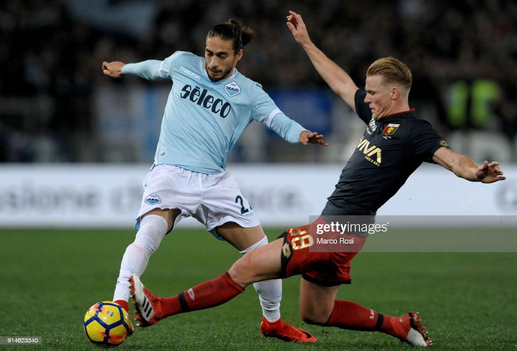 Martin Caceres of SS Lazio compete for the ball with Oscar Hiljemark of Genoa during the Serie A match between SS Lazio and Genoa at Stadio Olimpico on February 5, 2018 in Rome, Italy.