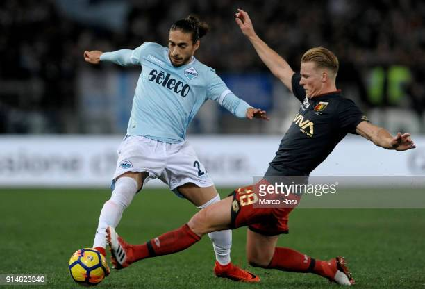 Martin Caceres of SS Lazio compete for the ball with Oscar Hiljemark of Genoa during the Serie A match between SS Lazio and Genoa at Stadio Olimpico...