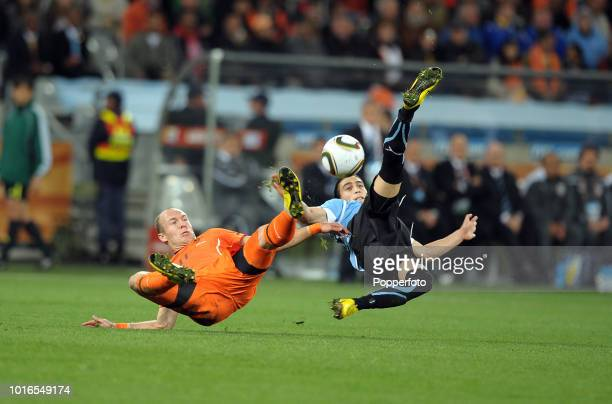 Martin Caceres of Uruguay and Arjen Robben of the Netherlands in action during the 2010 FIFA World Cup Semi Final match between Uruguay and the...
