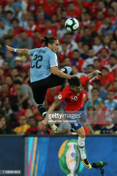 Martin Caceres of Uruguay competes for the ball with Charles Aranguiz of Chile during the Copa America Brazil 2019 group C match between Chile and...