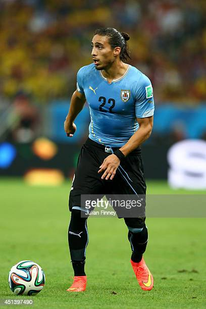 Martin Caceres of Uruguay controls the ball during the 2014 FIFA World Cup Brazil round of 16 match between Colombia and Uruguay at Maracana on June...