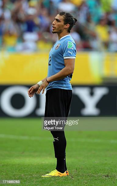 Martin Caceres of Uruguay reacts to missing a penalty during a shootout during the FIFA Confederations Cup Brazil 2013 3rd Place match between...