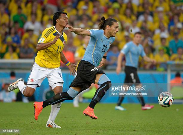 Martin Caceres of Uruguay with Juan Cuadrado of Colombia during the 2014 FIFA World Cup Brazil round of 16 match between Colombia and Uruguay at...