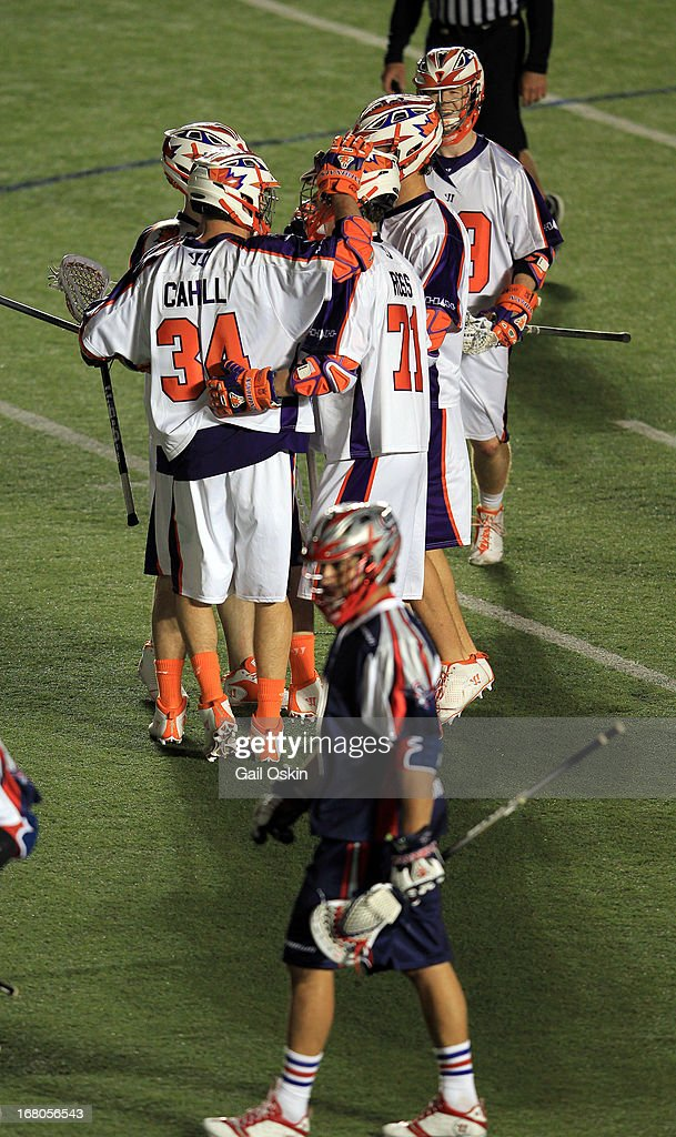 Martin Cahill #34 of the Hamilton Nationals congratulates his teammate Kevin Ross #71for his goal in the fourth quarter in a game against the Boston Cannons at Harvard Stadium May 4, 2013 in Boston, Massachusetts. The Hamilton Nationals defeated the Boston Cannons 15-8.