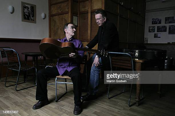 Martin Carthy folk singer and guitarist sitting talking to Tom Robinson songwriter radio presenter and bisexual activist 11th May 2010