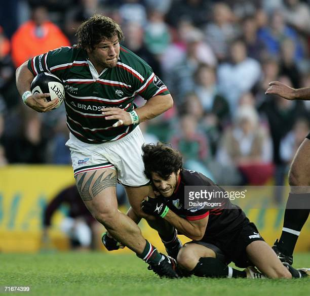 Martin Castrogiovanni of Leicester Tigers is tackled by Benoit Marfaing during the pre-season friendly match between Leicester Tigers and Toulon at...