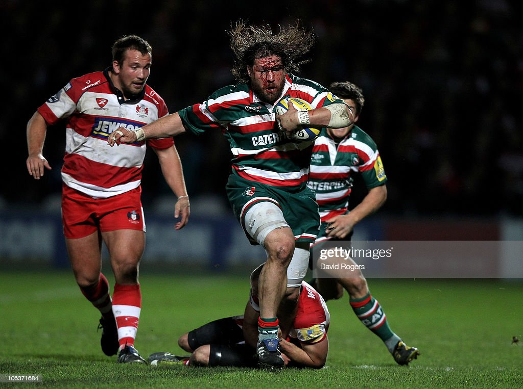 Martin Castrogiovanni of Leicester Tigers is tackled by Charlie Sharples during the Aviva Premiership match between Gloucester and Leicester Tigers at Kingsholm on October 30, 2010 in Gloucester, England.