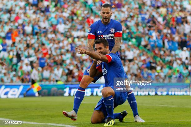 Martin Cauteruccio of Cruz Azul celebrates with teammate Edgar Mendez after scoring the first goal of his team during the 7th round match between...