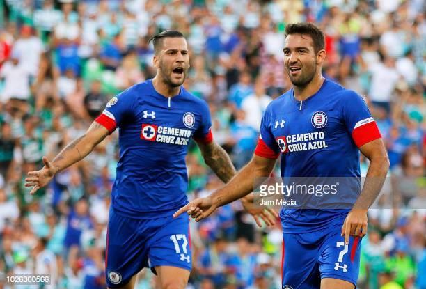 Martin Cauteruccio of Cruz Azul celebrates with teammate Edgar Mendez after scoring the first goal during the 7th round match between Santos Laguna...