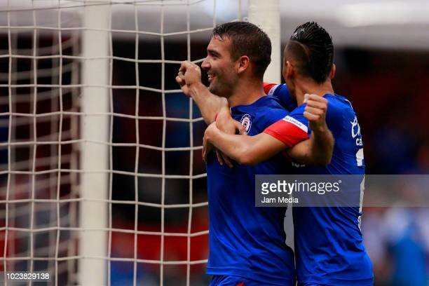 Martin Cauteruccio of Cruz Azul celebrates with teammate Roberto Alvarado after scoring the first goal of his team during the 6th round match between...