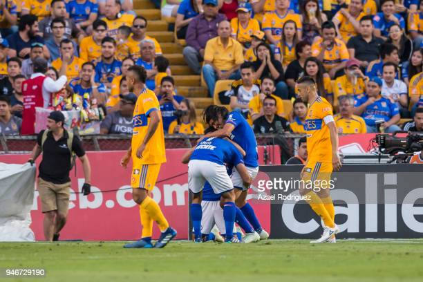 Martin Cauteruccio of Cruz Azul celebrates with teammates after scoring his team's first goal during the 15th round match between Tigres UANL and...