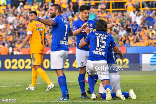 Martin Cauteruccio of Cruz Azul celebrates with teammates after scoring the first goal of his team during the 15th round match between Tigres UANL...