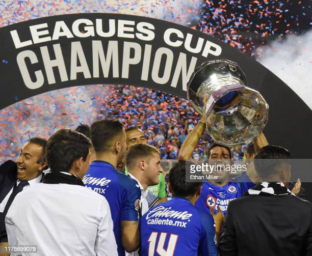 Martin Cauteruccio of Cruz Azul holds up the trophy as he and his teammates celebrate their 2-1 win over Tigres UANL in the Leagues Cup final at Sam...