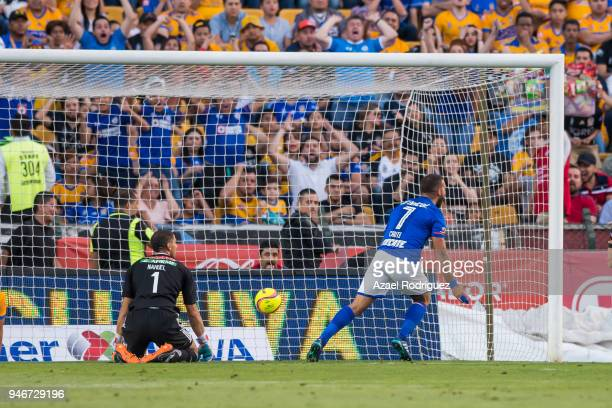Martin Cauteruccio of Cruz Azul reacts after scoring his team's first goal over Nahuel Guzman goalkeeper of Tigres during the 15th round match...