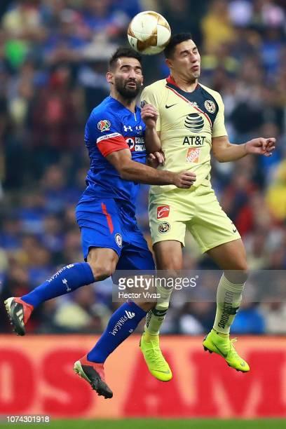 Martin Cauteruccio of Cruz Azul struggles for the ball with Jorge Sanchez of America during the final second leg match between Cruz Azul and America...