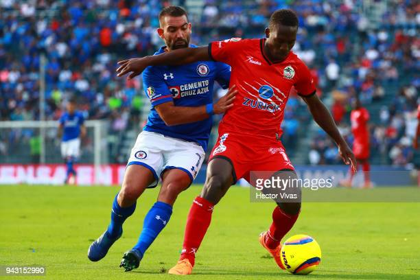 Martin Cauteruccio of Cruz Azul struggles for the ball with Luis Advincula of Lobos BUAP during the 14th round match between Cruz Azul and Lobos BUAP...