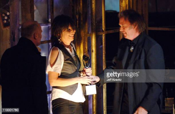 Martin Chambers and Chrissie Hynde of The Pretenders, inductees, with Neil Young, presenter