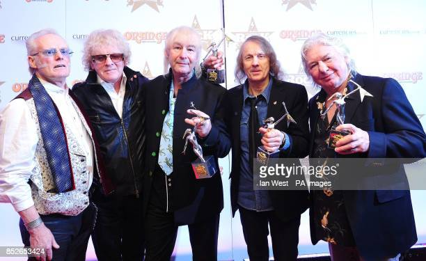 Martin Chambers Ian Hunter Pete Overend Watts Verden Allen and Mick Ralphs of Mott The Hoople with their Outstanding Contribution award at the...