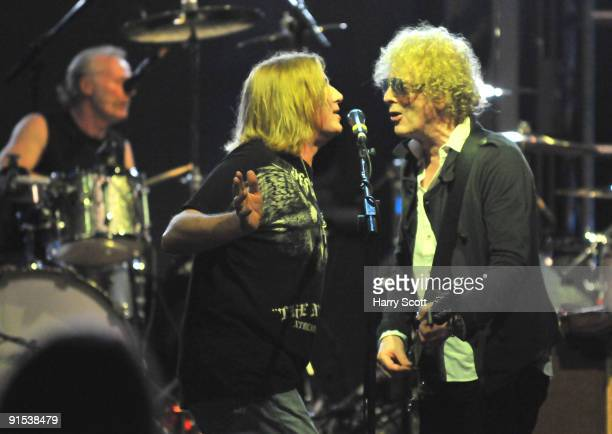 Martin Chambers Joe Elliott of Def Leppard and Ian Hunter of Mott The Hoople perform on stage at Hammersmith Apollo on October 1 2009 in London...