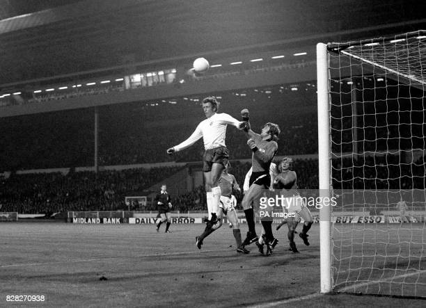 Martin Chivers jumps to head England's first goal, which was really scored by Mike Channon: he is almost hidden by Austrian goalkeeper F Koncilia,...