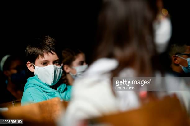 Martin Collinge wearing a protective mask attends a class at the Sacre Coeur de Lindthout secondary school, in Brussels, on September 1, 2020. - Six...
