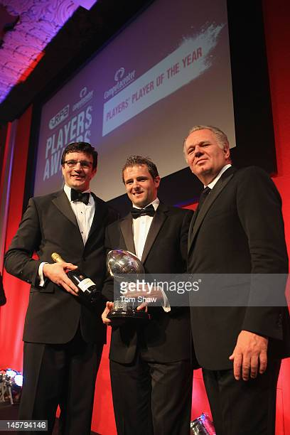 Martin Corry, Nick Evans of Harlequins and Mike Norris of Computacentre and pose with the Computacentre Players Player of the Year Award during the...