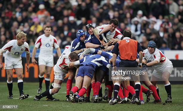 Martin Corry of England receives an elbow in the face from Jerome Thion of France whilst competing in a scrum during the RBS Six Nations match...