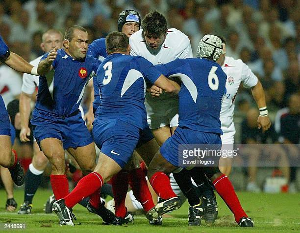 Martin Corry of England trys to break through the tackle of Sylvain Marconnet and Serge Betsen of France during the Rugby Union International match...
