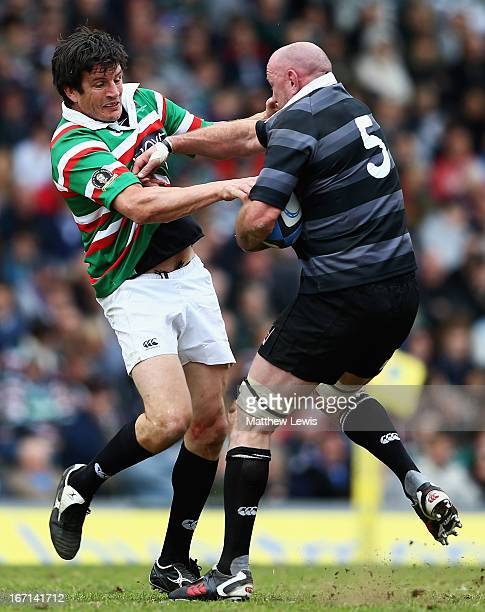Martin Corry of Louis Deacon's Tigers tackles Trevor Brennan of Matt Hampson International Legends during the Leicester Tigers Legends Match between...