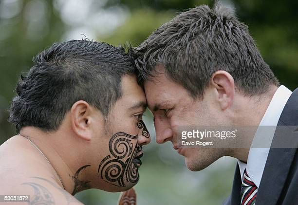 Martin Corry of the British and Irish Lions performs the Hongi with a Maori Warrior during their visit to a Marae on June 11 2005 in Ngaruawahia New...