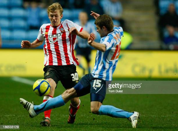 Martin Craine of Coventry City and James WardProwse of Southampton battle for the ball during the FA Cup 3rd round match between Coventry City and...