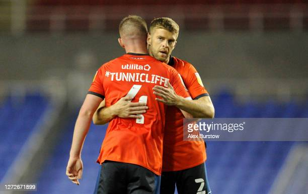 Martin Cranie and Ryan Tunnicliffe of Luton Town celebrate victory on the final whistle during Carabao Cup Second Round match between Reading FC and...