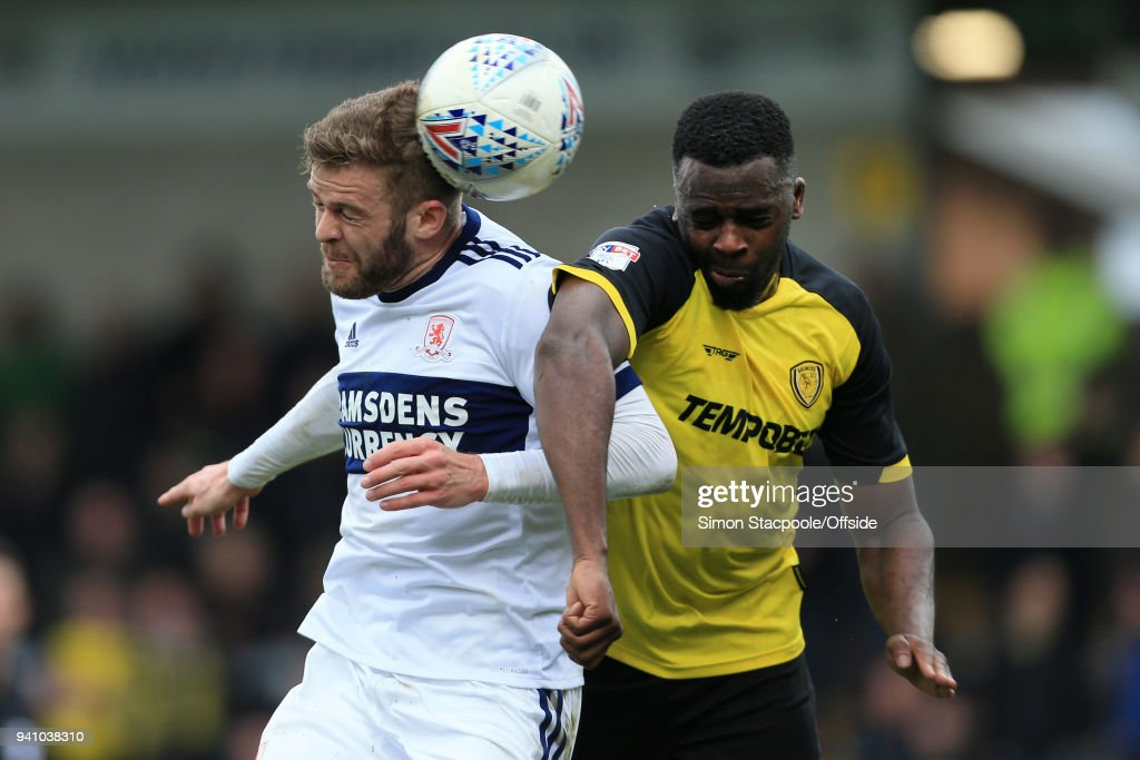 Martin Cranie of Boro battles with Hope Akpan of Burton during the Sky Bet Championship match between Burton Albion and Middlesbrough at the Pirelli Stadium on April 2, 2018 in Burton-upon-Trent, England.