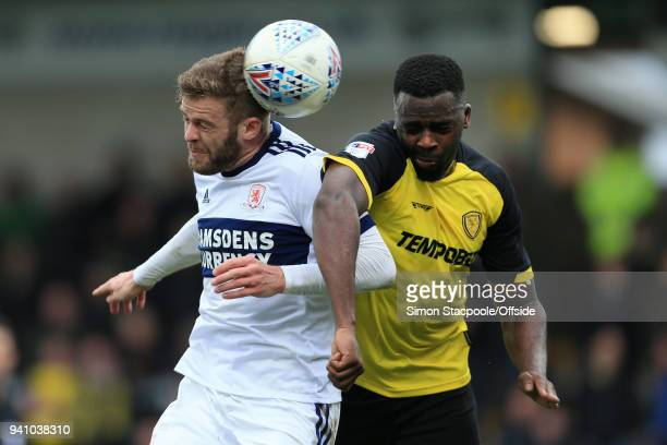 Martin Cranie of Boro battles with Hope Akpan of Burton during the Sky Bet Championship match between Burton Albion and Middlesbrough at the Pirelli...