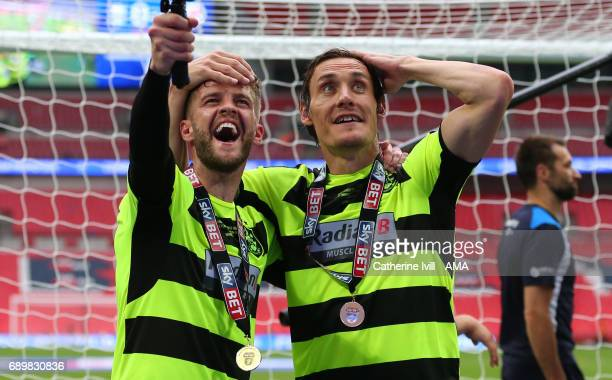 Martin Cranie of Huddersfield Town and Dean Whitehead of Huddersfield Town celebrate after the Sky Bet Championship Play Off Final match between...