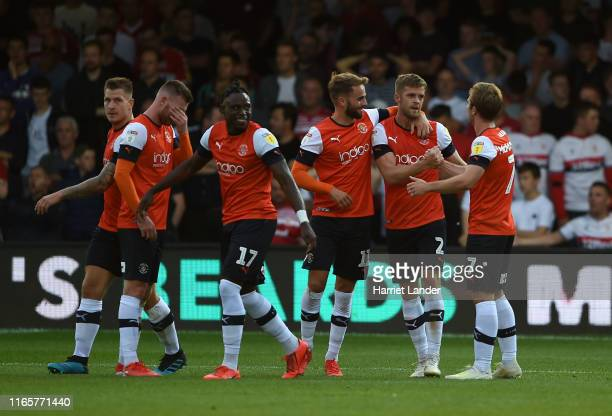 Martin Cranie of Luton Town celebrates with teammates after scoring his team's second goal during the Sky Bet Championship match between Luton Town...