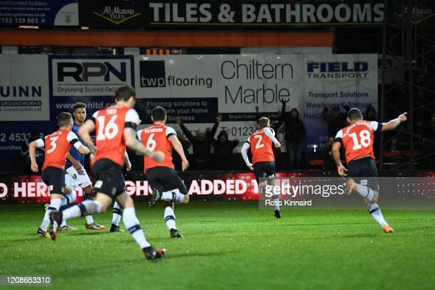 Martin Cranie of Luton Town runs towards the fans to celebrate after scoring his team's second goal during the Sky Bet Championship match between...