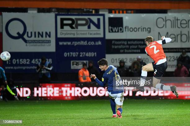 Martin Cranie of Luton Town scores his team's second goal past Christian Noergaard of Brentford during the Sky Bet Championship match between Luton...