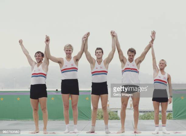 Martin Cross, Richard Budgett, Andy Holmes, and Steve Redgrave and Adrian Ellison of Great Britain celebrate winning gold at the Men's Coxed Fours...