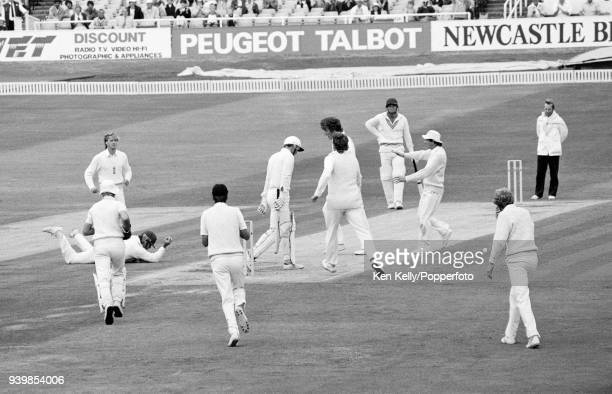 Martin Crowe of New Zealand is caught by Allan Lamb of England for 1 run off the bowling of Bob Willis during the 2nd Test match between England and...