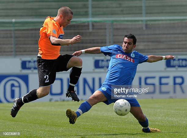 Martin Dausch of VfR Aalen and Vincenzo Marchese of Stuttgarter Kickers challenge for the ball during the Regionalliga match between VfR Aalen and...