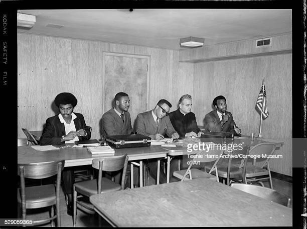 Martin Davis Frank Knight Franklin Jerry Alan Stewart Monsignor Paul Bassompierre and Elgia McCoy seated at tables for Knights of Peter Claver...