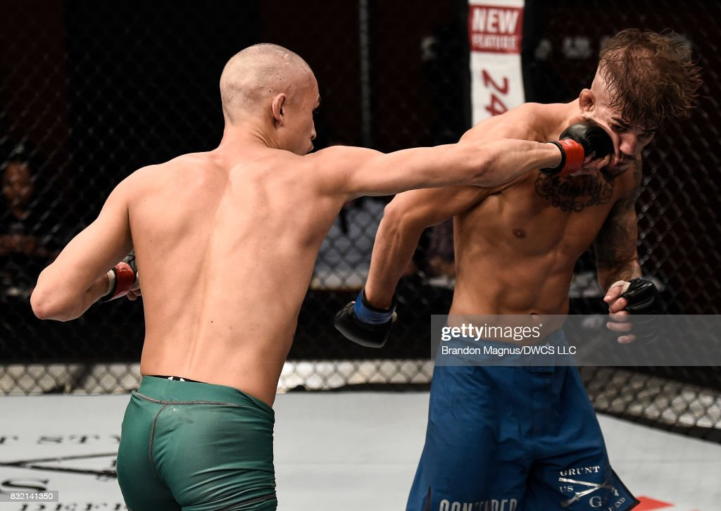 Martin Day punches Jaime Alvarez in their flyweight bout during Dana White's Tuesday Night Contender Series at the TUF Gym on August 15, 2017 in Las Vegas, Nevada.