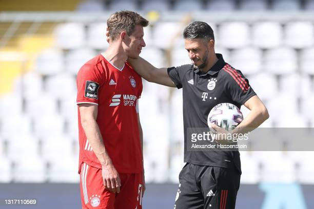 Martin Demichelis, coach of Bayern München reacts with his player and team captain Nicolas Feldhahn after the 3. Liga match between Bayern München II...