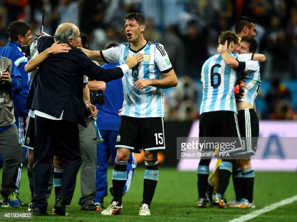 Martin Demichelis of Argentina celebrates the win by the penalty shootout with head coach Alejandro Sabella of Argentina after the 2014 FIFA World...